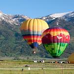 Balloons rising in front of Jackson Ski Resort, WY sunrise.